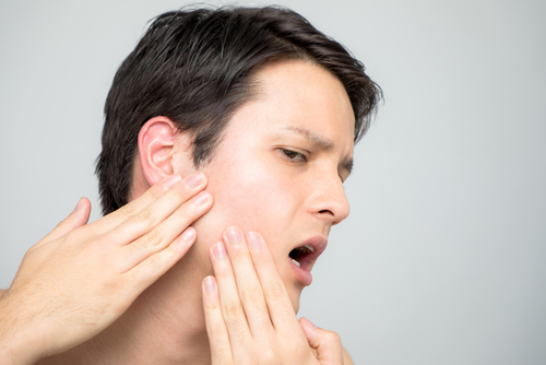 Jaw pain is one of the TMJ symptoms.